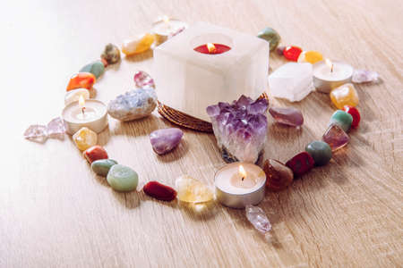 Setting up a semi precious stone crystal grid in home helps your intentions to manifest concept. Alternative lifestyle.