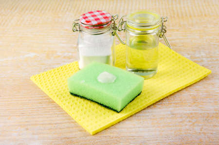 Side view of nature and eco friendly natural cleaner baking soda and olive oil paste on washing sponge for cleaning home, removing stains, non toxic cleaning product concept. Copy space. Standard-Bild