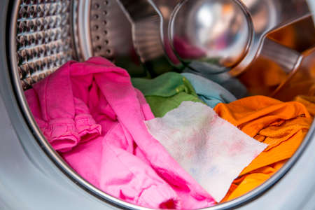 Color absorbing sheet inside a washing machine, allows to wash mixed color clothes without ruining colors concept.
