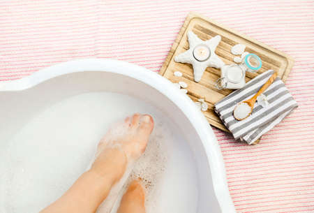 Taking magnesium foot bath for better absorbent of vitamin mineral magnesium chloride. Soaking feet in relaxing bath. Relieves muscle tension, aid to skin and bone health, suitable during pregnancy.