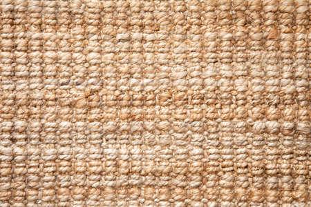 Flat lay view of natural color braided jute (Corchorus olitorius and Corchorus capsularis)material doormat. Background texture concept.