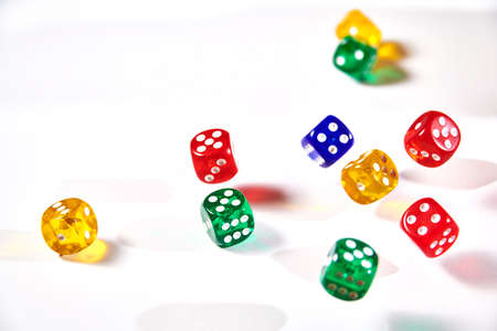 colorful dices in motion on white background