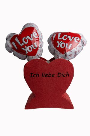 Two hearts as balloons with the words I love you are in a red heart with the words I love you