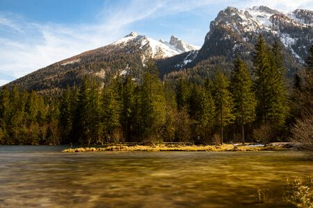 Mountain lake in thae Bavarian Alps in spring and snow on the mountains.