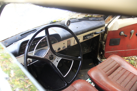 drivers seat: looking at the dashboard in a vintage car