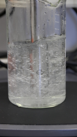 Homogenizing a wastewater sample in the laboratory of a wastewater treatment plant