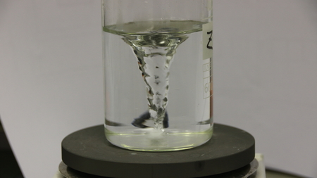 Agitation of a wastewater sample in the laboratory of a wastewater treatment plant. The stirring is done with a magnetic stirrer with hotplate. Stock Photo