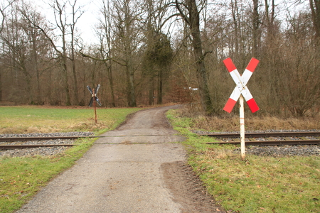 St. Andrew's Cross at an unmarked railroad crossing of the Strohg?ubahn in the Heckeng?u near Weissach