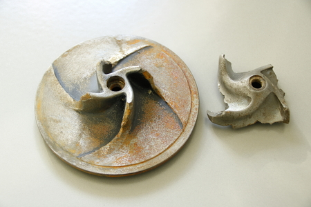 Impeller of a water pump. The impeller is heavily worn by stones. Reklamní fotografie
