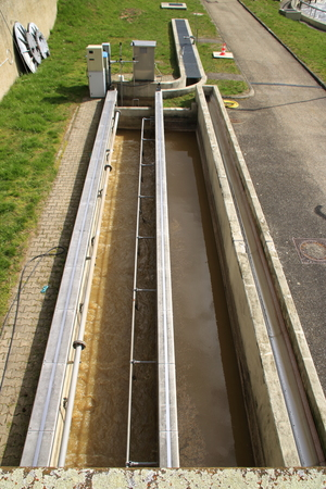 Ventilated sand trap and grease trap in the inlet of a sewage treatment plant Stock Photo