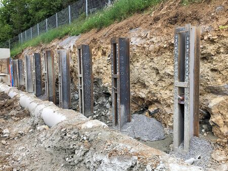 Steel girders were concreted in the ground for slope protection