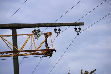 Construction crane drives at safety distance under a power line Stock Photo