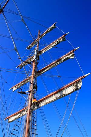 Main mast on a sailing ship with 4 sails