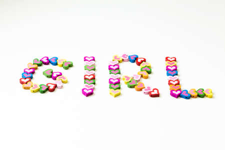 word - GIRL - from the multicolored wood hearts - G I R L photo