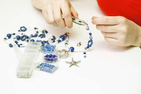 necklase: Woman making necklase from colorful plastic beads Stock Photo