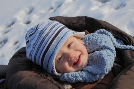 icily: Boy on sledge, icily Stock Photo