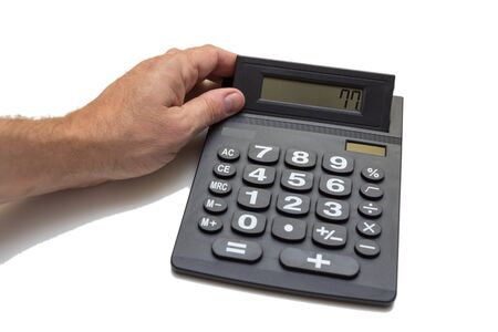 free plates: pocket calculator with hand Stock Photo