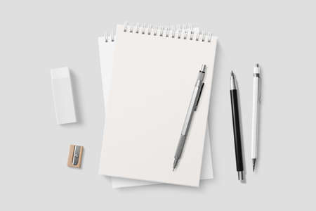 Blank realistic spiral bound notepad mockup on light gray background. High resolution.
