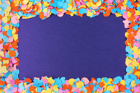 Confetti Frame On Slate - New Year, Carnival Party Concept Stock Photo