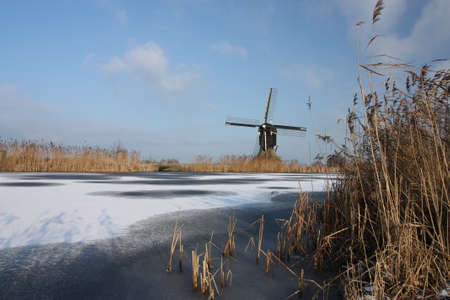 dutch windmill in winter photo