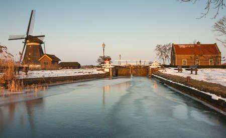 sluice: windmill and sluice house in winter