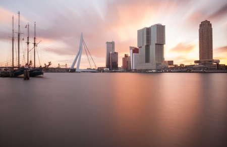 citytrip: rotterdam skyline with tallship at sunrise
