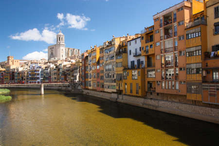citytrip: historical city of girona with colored houses and church