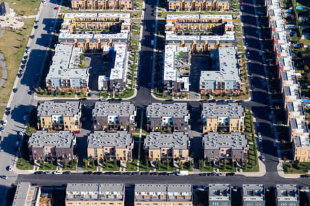 property development: Aerial view over a modern new Montreal housing complex recently built, Canada