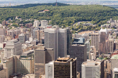 Aerial view of downtown Montreal and its skyscrapers at the foot of famed Mount-Royal on a sunny summer day. Quebec, Canada.