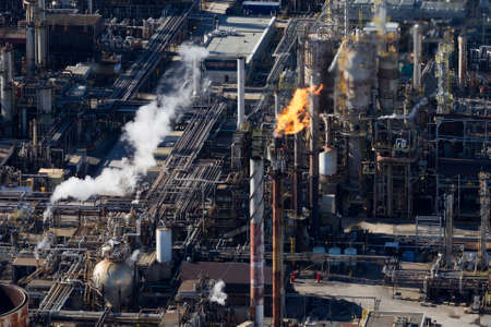 Aerial view of an fire burning stack at and oil & gas refinery plant, Canada.