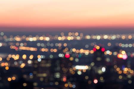 City night light blur bokeh at dawn , defocused background Imagens