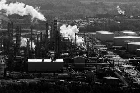 reservoirs: Black & white aerial view of an oil and gas refinery and reservoirs. Stock Photo
