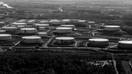 Black and white Aerial view of reservoirs at and oil and gas refinery plant.