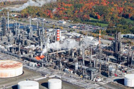 reservoirs: Aerial view of an oil and gas refinery and reservoirs near the colorful autum forest.