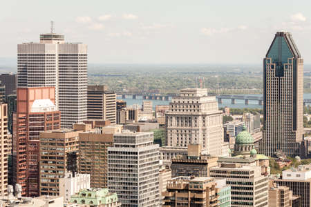 vue: Part of downtown Montreal and its iconic buildings seen from the Mount Royal, Canada.