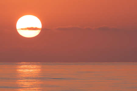 Spectacular sunrise over the ocean, close up landscape view.