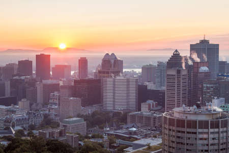 Montreal summer skyline view at sunrise seen from the Mount royal. Canada.