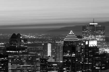 Dramatic black and white Montreal skyline oview n a foggy summer night, Canada