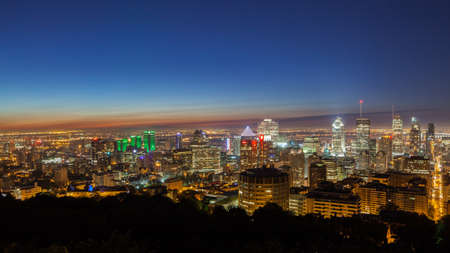 Montreal summer skyline view at dawn seen from the Mount royal. Canada.