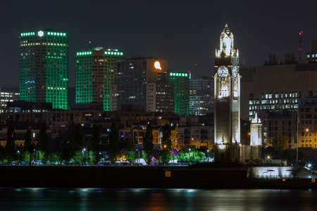 Night view on the Montreal skyline and the famed clock tower landmark in the Old Port, Canada.