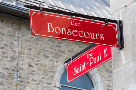 disctrict: Old Montreal and Old Port signs telling the distance and direction to the historical quarter, Canada.
