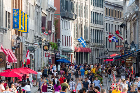 Old Montreal, July 1, 2015. Tourists and visitors walking and discovering the historical quarter on Canada day. Editorial