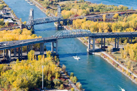 Montreal October 20, 2016. Aerial view over the Ste-Lawrence seaway and a small boat cruising under the Mercier bridge at fall. Canada