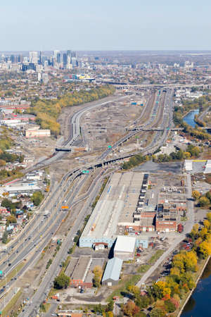 Montreal, October 20, 2016. Aerial view looking east toward downtown Montreal showing the Turcot construction project at fall along the Lachine canal. Canada