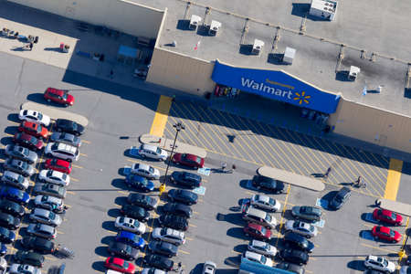Montreal, October 13, 2016. Aerial view over the Walmart Supercentre retail store on a busy shopping day with customers reaching for their cars after making their purchase. Canada