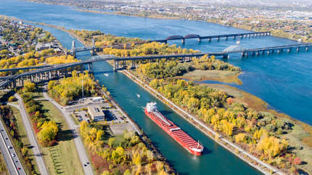 Montreal, October 20, 2016. Aerial view over the Ste-Lawrence seaway at the Mercier bridge linking Chatauguay to the Montreal island seen at fall. Canada.