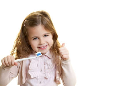 little girl with dentist tool Standard-Bild
