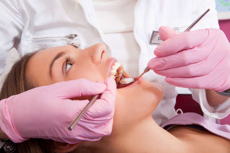 mouth: dentist and beautiful patient Stock Photo