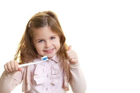 Happy smiling girl with dentist tool Standard-Bild