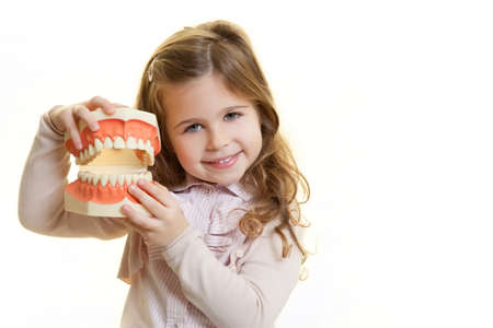little girl with dentist tool Standard-Bild